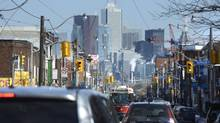 Traffic moves along Dundas Street West in downtown Toronto on March 3 2014. (FRED LUM/THE GLOBE AND MAIL)