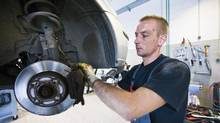 A mechanic changes brake discs on a Ford Focus vehicle. (Horus/The Canadian Press/Action Press)