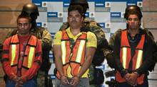 "Julian Zapata Espinoza (C), aka ""El Piolin"", alleged member of Zetas drug trafficking gang, is presented with other alleged gang members at a press conference in Mexico City on February 23, 2011. Julian Zapata Espinoza is a suspect in the murder of US Immigration and Customs Enforcement agent Jaime Zapata. (RONALDO SCHEMIDT/Ronaldo Schemidt/AFP/Getty Images)"