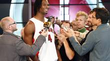 Chris Bosh, seen having a laugh while speaking with reporters during the Toronto Raptors' media day earlier this month, has won a court case involving domain names. (MIKE CASSESE/Mike Cassese/Reuters)