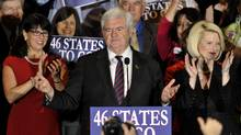 U.S. Republican presidential candidate and former Speaker of the House Newt Gingrich is accompanied by his wife Callista (R) as he addresses supporters at his Florida primary night rally in Orlando, Florida January 31, 2012. (OCTAVIAN CANTILLI/REUTERS/OCTAVIAN CANTILLI/REUTERS)