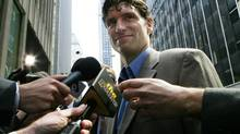 Steve Moore of the NHL team the Colorado Avalanche is surrounded by reporters after leaving NHL headquarters in New York, April 26, 2005. (MIKE SEGAR/REUTERS)