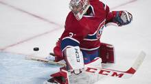 Montreal Canadiens goaltender Carey Price looks back as the puck comes off his post from a shot by the New York Rangers during second period NHL action in Montreal, Saturday, April 12, 2014. (Graham Hughes/THE CANADIAN PRESS)