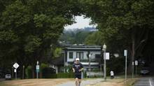 A runner makes his way through the Point Grey neighbourhood in Vancouver, British Columbia, Thursday, August 23, 2012. (Rafal Gerszak for The Globe and Mail)