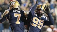 Winnipeg Blue Bombers' Jason Vega, seen in this 2012 photo, celebrating a touchdown with Alex Brink (John Woods/The Canadian Press)