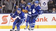 Toronto Maple Leafs' Zach Hyman (11) Auston Matthews (34) and William Nylander (39) celebrate a goal by Morgan Rielly (not shown) during the third period of NHL hockey pre-season action against the Montreal Canadiens in Toronto on October 2, 2016. (Frank Gunn/THE CANADIAN PRESS)