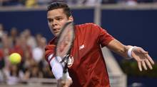 Milos Raonic, of Canada, retuns to Feliciano Lopez, of Spain during in Rogers Cup tennis quarter final action in Toronto on Friday August 8, 2014. (Nathan Denette/THE CANADIAN PRESS)