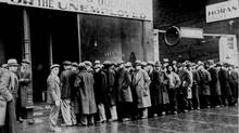 "Unemployed men queued outside a depression soup kitchen opened in Chicago by Al Capone. The storefront sign reads ""Free Soup, Coffee and Doughnuts for the Unemployed."" February 1931. (National Archives)"