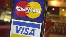 MasterCard and Visa. (MARK LENNIHAN/AP)