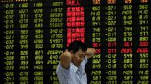 A Chinese investor in front of an electronic stock board at a brokerage house in Fuyang city in central China's Anhui province. (AP)