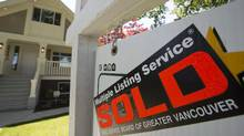 Real estate agents say home sales continued to fall dramatically in the Vancouver area. (Jonathan Hayward/The Canadian Press)