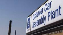 A sign stands outside Oshawa's General Motors car assembly plant in Oshawa, Canada. (Michelle Siu/THE CANADIAN PRESS)