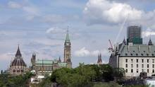 The Peace Tower of Parliament Hill is seen with the Supreme Court of Canada on May 22, 2014 in Ottawa. (Dave Chan for The Globe and Mail)