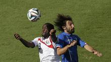 Costa Rica's Joel Campbell, left, and Italy's Andrea Pirlo go for a header during the group D World Cup soccer match between Italy and Costa Rica at the Arena Pernambuco in Recife, Brazil, Friday, June 20, 2014. (Hassan Ammar/AP)