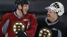 Boston Bruins goalie Tim Thomas, right, jokes with teammate Shawn Thornton. (AP Photo/Charles Krupa) (The Associated Press/Charles Krupa)
