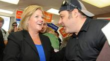 Ontario NDP Leader Andrea Horwath greets supporters at Sudbury NDP candidate Paul Loewenberg's campaign office in Sudbury on Tuesday Oct. 4, 2011. (THE CANADIAN PRESS / Gino Donato/THE CANADIAN PRESS / Gino Donato)