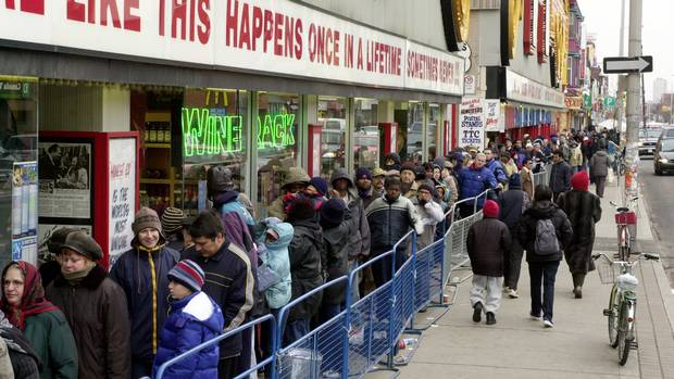 At Honest Ed's Annual Christmas Free Christmas Turkey giveaway on Nov. 24, 2002, People lined up along Bloor Street waiting to get into the store for the free handouts of turkeys and fruitcakes.