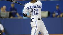 Toronto Blue Jays Edwin Encarnacion hits a grand slam in the seventh inning of their MLB American League baseball game against the Houston Astros in Toronto July 26, 2013. (STRINGER/CANADA/REUTERS)