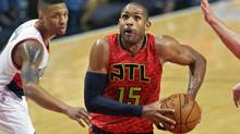Atlanta Hawks' Al Horford, right, drives past Portland Trail Blazers' Damian Lillard. The pending free agent centre was one of the all-star-calibre players whose name was floated in recent days. (Craig Mitchelldyer/AP Photo)
