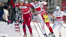 Canada's Devon Kershaw, right, slips past Norway's Anders Gloeersen at a World Cup race in Quebec City last Friday. (Jacques Boissinot/THE CANADIAN PRESS)
