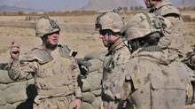 Task Force Kandahar Commander, Brigadier General Daniel Ménard receives a briefing from Captain James O'Neill of Delta Company. Joint Task Force Afghanistan (JTF-Afg) is Canada's military contribution to Afghanistan. (Master Corporal Angela Abbey)