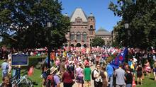 Teachers rally outside on the front lawn of the Ontario legislature at Queen's Park in Toronto. (Fred Lum/The Globe and Mail)