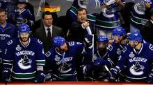 Head coach Alain Vigneault of the Vancouver Canucks shouts from the bench against the Boston Bruins during game one of the 2011 NHL Stanley Cup Finals at Rogers Arena on June 1, 2011 in Vancouver, Canada. (Rich Lam/Getty Images)