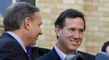 Republican presidential candidate, former Pennsylvania Sen. Rick Santorum, center, holds a pair of boxing gloves at a campaign stop in Hollidaysburg, Pa. (Jae C. Hong/Jae C. Hong/AP)