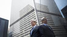 Dave McKay, CEO of RBC, poses in front of Royal Bank Plaza on Bay Street in Toronto on Friday, July 25, 2014. (Darren Calabrese for The Globe and Mail)