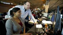 Krystal Joseph and Blake Pridmore work at I Love Rewards in Toront. (Kevin Van Paassen/The Globe and Mail/Staff)