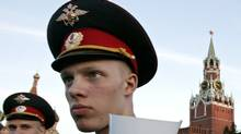A police cadet guards the Day of Russia holiday celebration at the Red Square late Tuesday, June 12, 2007. (IVAN SEKRETAREV/IVAN SEKRETAREV/AP)