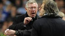 Manchester United's coach Alex Ferguson (L) gestures towards Manchester City's coach Roberto Mancini (R) during their English Premier League match at the Etihad stadium in Manchester, northern England April 30, 2012. (NIGEL RODDIS/REUTERS)