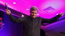 Prime Minister Stephen Harper sings during the Conservative caucus Christmas party in Ottawa December 8, 2010. (CHRIS WATTIE/REUTERS)