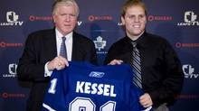 Phil Kessel, seen with Maple Leafs GM Brian Burke, isn't ready to make his Toronto debut. (Darren Calabrese/CP)