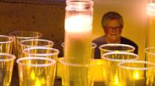 A photo of Julie Paskall is surrounded by candles during a vigil in Surrey, B.C., on Jan. 18, 2014. (Darryl Dyck/The Canadian Press)