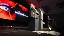 Barnaby Jack demonstrates an attack on two automated teller machines during the Black Hat technology conference in Las Vegas on Wednesday, July 28, 2010. The attacks demonstrated Wednesday targeted standalone ATMs. But they could potentially be used against the ATMs operated by mainstream banks (Isaac Brekken/AP Photo/Isaac Brekken)