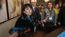 Manitoba Premier Greg Selinger and Perry Bellegarde, Assembly of First Nations National Chief, listen as Native Women's Association of Canada head Dawn Lavell-Harvard speaks to media in Winnipeg on Feb. 25. (JOHN WOODS/THE CANADIAN PRESS)