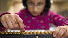 Student Vedanshi Vala, 10, takes part in an advanced after-school abacus class in Richmond, B.C. on Jan. 11, 2012. (JOHN LEHMANN/JOHN LEHMANN/THE GLOBE AND MAIL)