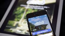 The Airbnb Inc. application is displayed on an Apple Inc. iPhone and iPad in this arranged photograph in Washington, D.C., U.S., on Friday, March 21, 2014. Vancouver is finalizing recommendations for short-term rentals, which will likely restrict them to people renting out their own homes through Airbnb, VRBO, HomeAway and other platforms with some kind of yearly cap on nights allowed. (Andrew Harrer/Bloomberg)