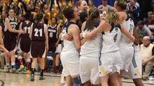 Members of the University of Windsor Lancers celebrate their 71-45 win over the Saint Mary's University Huskies, in gold medal game action at the CIS Women's National Basketball Championship tournament, Sunday March 16, 2014 in Windsor, Ontario. (Dave Chidley/THE CANADIAN PRESS)
