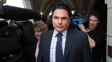 Senator Patrick Brazeau leaves the Senate on Parliament Hill October 25, 2013 in Ottawa. (Dave Chan For The Globe and Mail)