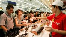 Shoppers at a Wal-Mart store in Shanghai in this 2005 file photo. (EUGENE HOSHIKO/EUGENE HOSHIKO/ASSOCIATED PRESS)