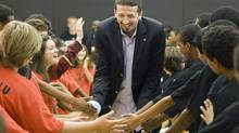Newly signed Toronto Raptors Hedo Turkoglu is greeted by children as he arrives for his introductory news conference in Toronto on Thursday July 9, 2009. The Turkish forward signed from the Orlando Magic. THE CANADIAN PRESS/Frank Gunn