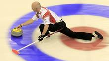 Canada skip Glenn Howard delivers his stone during play against Sweden at the World Men's Curling Championship 2012 in Basel April 4, 2012. (ARND WIEGMANN/Reuters)
