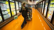 A Loblaws manager picks up groceries for a customer at a Toronto store. (Kevin Van Paassen for The Globe and Mail)