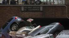 The storm surge caused by Hurricane Sandy left vehicles submerged in a parking structure in the financial district of Lower Manhattan, Oct. 30, 2012. The southern tip of Manhattan, where Wall Street and the NYSE are located, was without power on Monday. (ADREES LATIF/REUTERS)