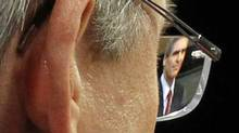 Liberal Leader Michael Ignatieff is framed by Tory Leader Stephen Harper's glasses as he answers a question during the English-language election debate in Ottawa on April 12, 2011. (Adrian Wyld/THE CANADIAN PRESS)