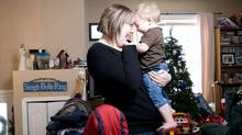 Jordana Simms plays with her son Nate, 14-months old, in their home in Sylvan Lake, Alta., on Jan. 1, 2010. (Jimmy Jeong for The Globe and Mail)