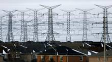 A power corridor runs alongside a residential development in Mississauga, Ont. The chair of Hydro One has promised to fix the utility's error-plagued billing system. (J.P. MOCZULSKI For The Globe and Mail)