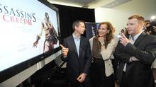 Ontario Premier Dalton McGuinty, left, Sandra Pupatello, Minister of Economic Development and Trade, and Yannis Mallat, CEO Ubisoft, appear at a Toronto press conference on Monday, July 6, 2009, announcing a new video game studio in Toronto, to create 800 jobs in Ontario. (Derek Oliver/The Canadian Press/Derek Oliver/The Canadian Press)